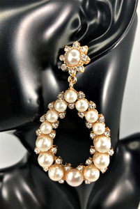 "Magnified image of the faux pearl teardrop shaped earring with rhinestone and gold accents. Approximately 2.75"" Length x 1"" Width, with post back."