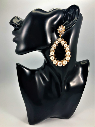 Faux Pearl teardrop shaped earring with rhinestone and gold accents. Approximately 2.75
