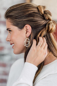 14k gold daydreamer earrings on model