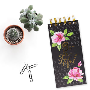 Floral on black notepad spiral bound