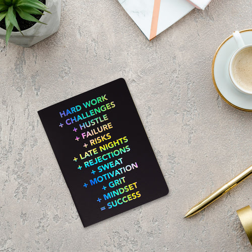 Success kraft book with black cover and rainbow text
