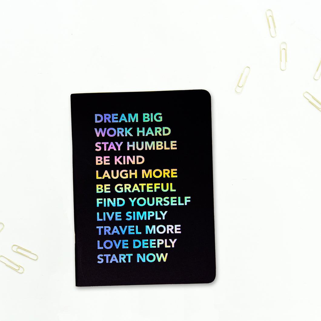 Start now a5 kraft book black cover with multicoloured text on the c over
