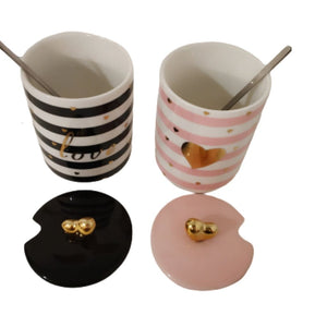 Ceramic pink and black striped mug set with lids and spoons