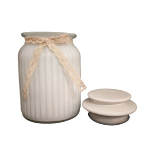 White glass jar with lid and embellishment