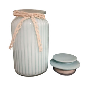 pastel blue glass jar with lid open