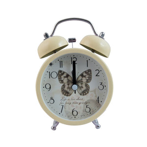 pale yellow alarm clock with butterfly