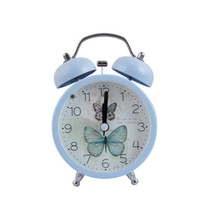 pale blue alarmclock with butterflies