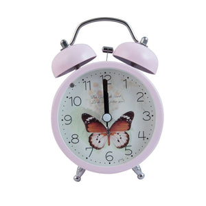 pastel pink alarm clock with butterfly