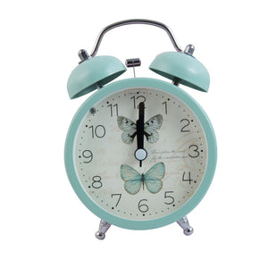 pastel green alarm clock with butterflies