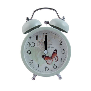 vintage pastel alarmclock wwith butterfly