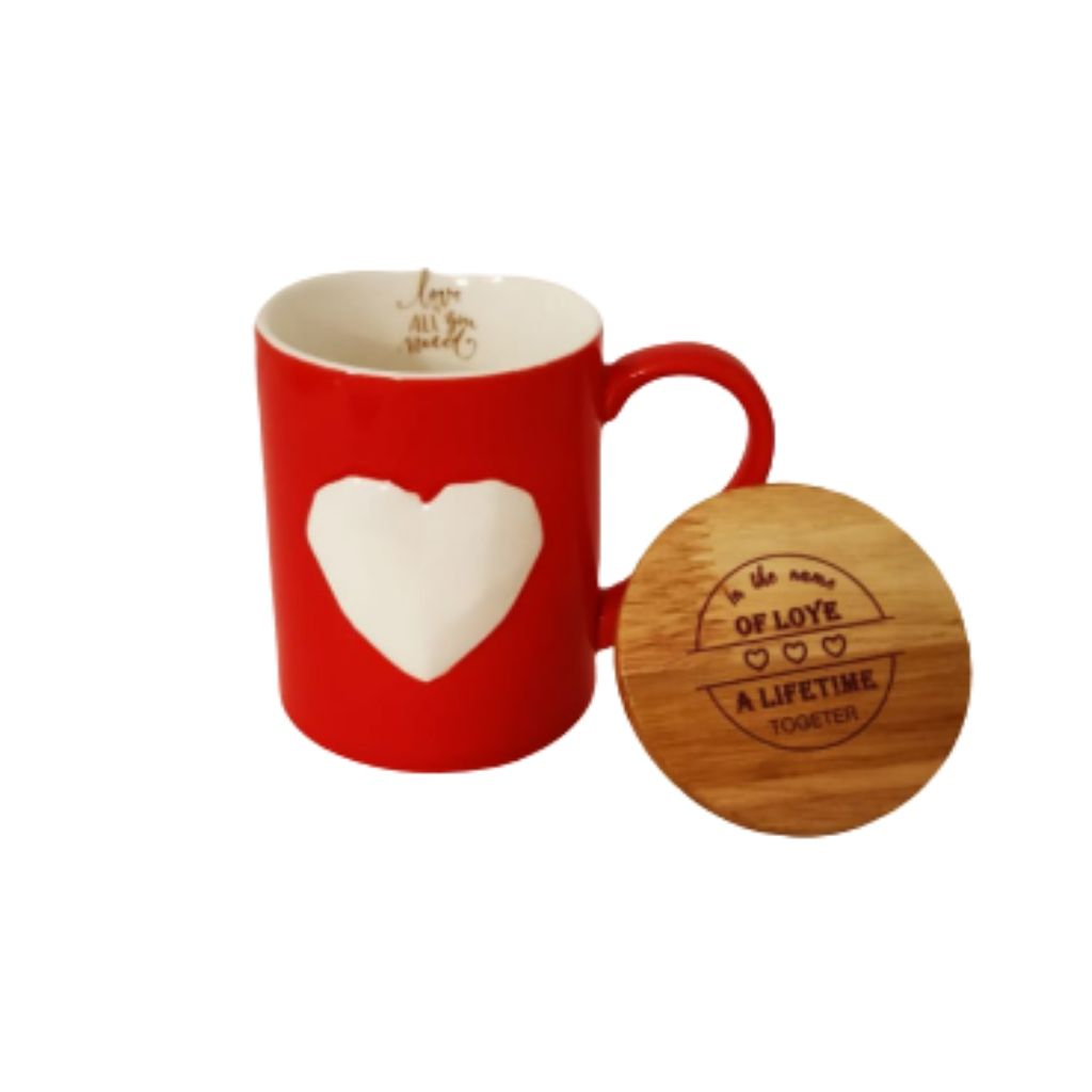 Red ceramic mug with white geometric heart and wooden lid open