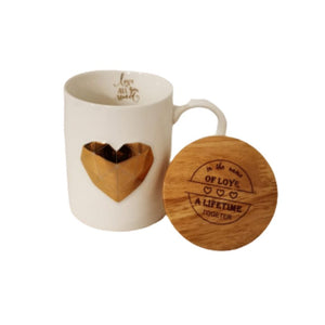 Open lid with white ceramic mug and gold heart