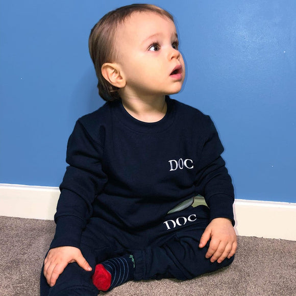 Personalised Baby Navy Tracksuit, being modelled
