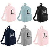 6 Different Personalised Mini Backpacks, with colours including Pink, Blue, Navy, Black and Grey