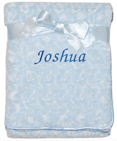 """This is the blue version of the rosebud blanket personalised with the name """"Joshua"""""""