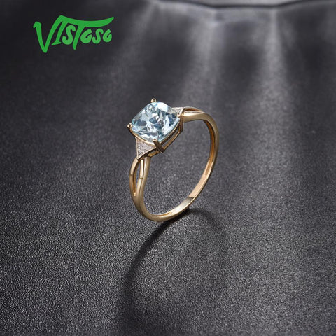 Yellow Gold Sparkling Diamond Limpid Blue Rings