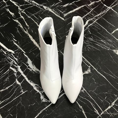white high-heeled Chelsea boots