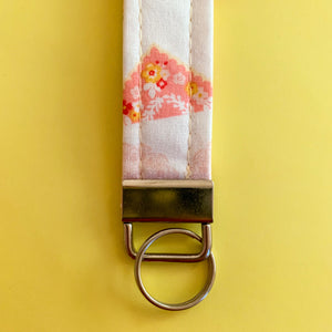 White Key Fob with Pink and Yellow Flags
