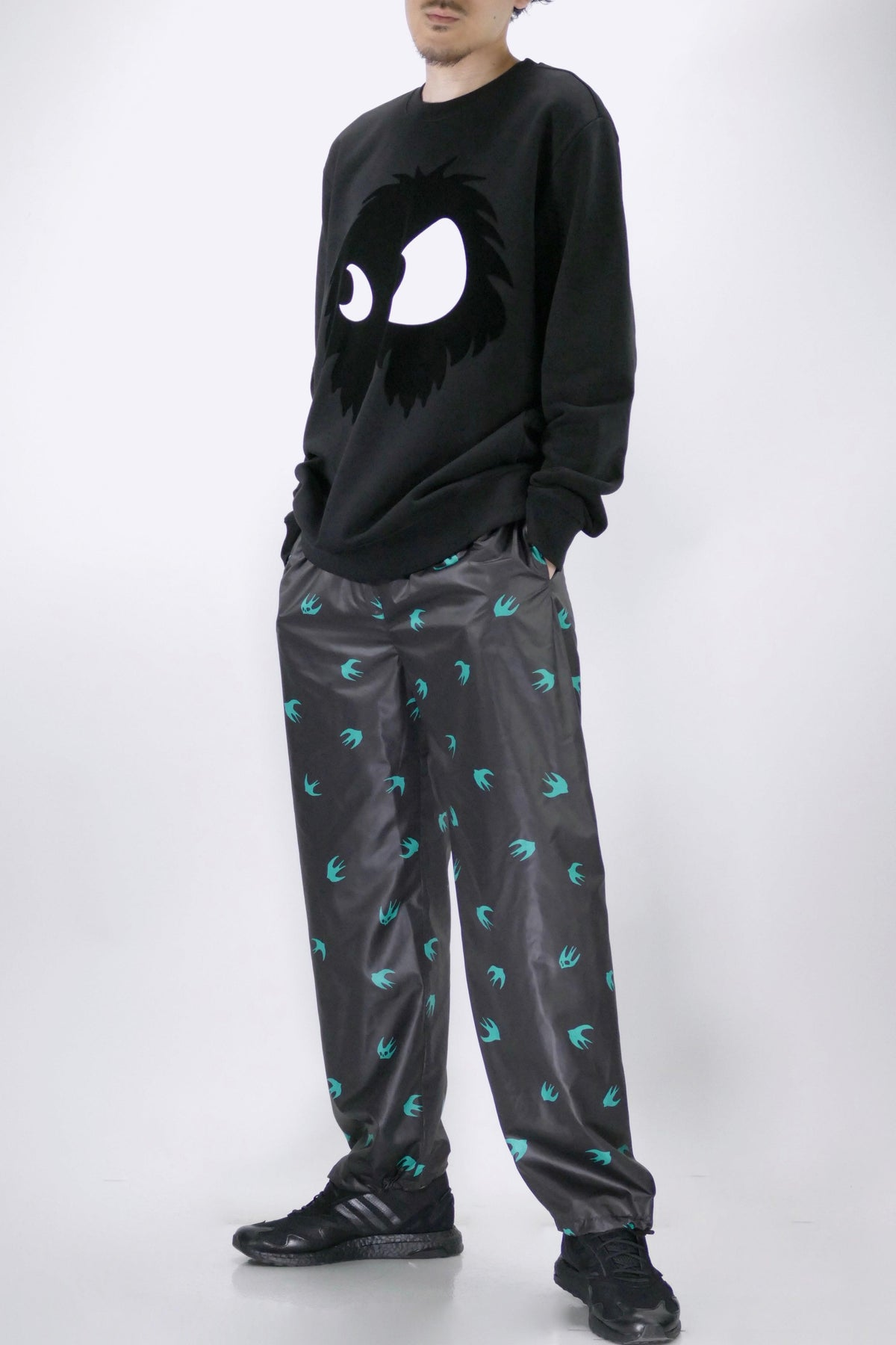 McQ Swallow Print Trackpants Black
