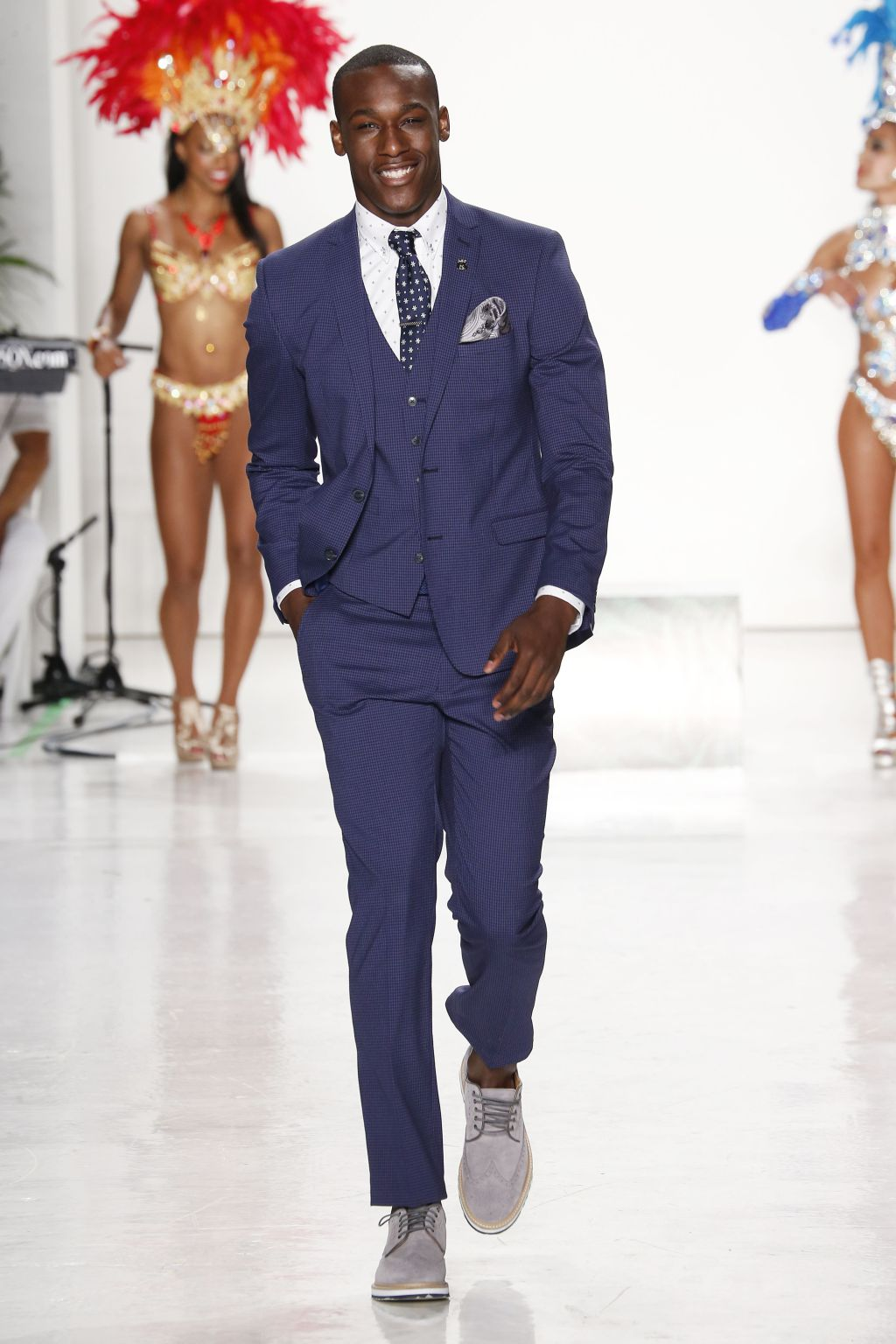 Male model Emmanuel Amorin walks Nick Graham runway