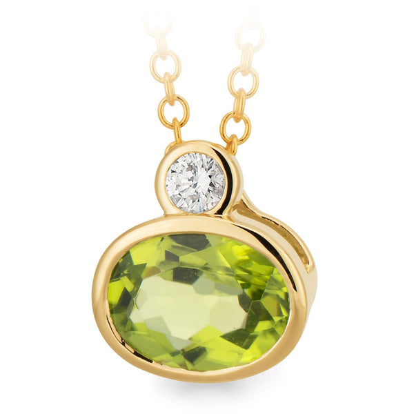 9K YELLOW GOLD PENDANT 1* PERIDOT 8* 6MM OVAL BEZ DIA 1= 0.6CT SI3 JK DBLE BEZ
