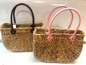 Leather handled woven basket tote