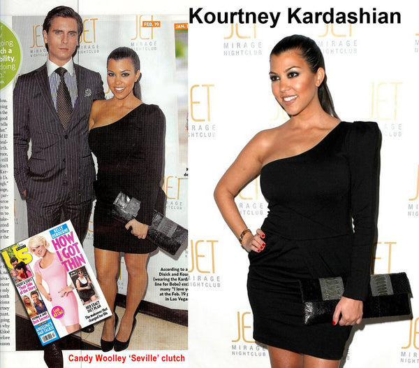Kourtney Kardashian with a Candy Woolley clutch at Dash fashion show in Vegas
