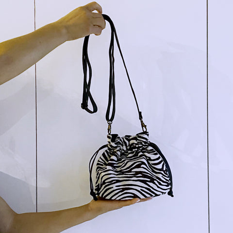 MINI DRAWSTRING POUCH. CALF HAIR, GENUINE LEATHER