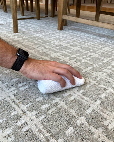To clean a carpet stain, take a dry white cloth and blot gently, but firmly, to lift the stain from the carpet