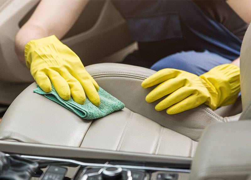 Clean leather upholstery with a microfiber cloth