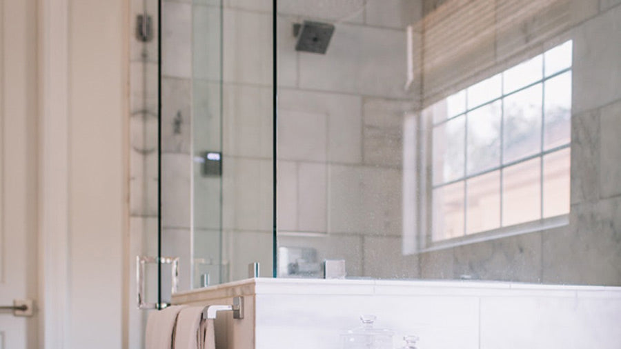 remove hard water stains from shower