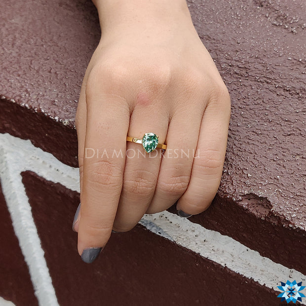 green moissanite ring