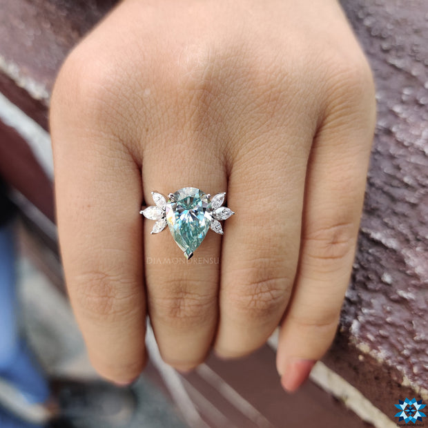 3.87 DEW Pear Cut with Marquise Cut Muse Setting Moissanite Wedding Ring