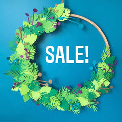 Wreath of paper leaves with Sale written inside