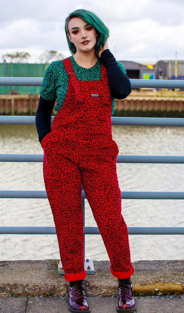 run & fly red corduroy dungarees on model Kat Hastings with teal leopard print tee and matching teal hair