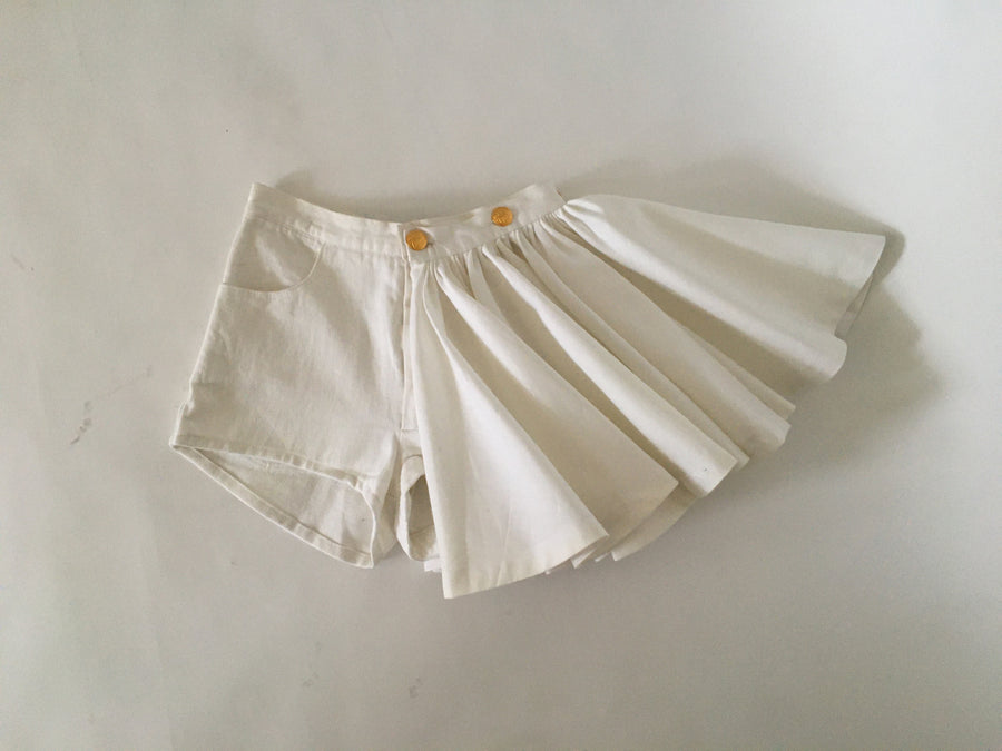 white denim shorts with button-on pleated 'skirt' piece