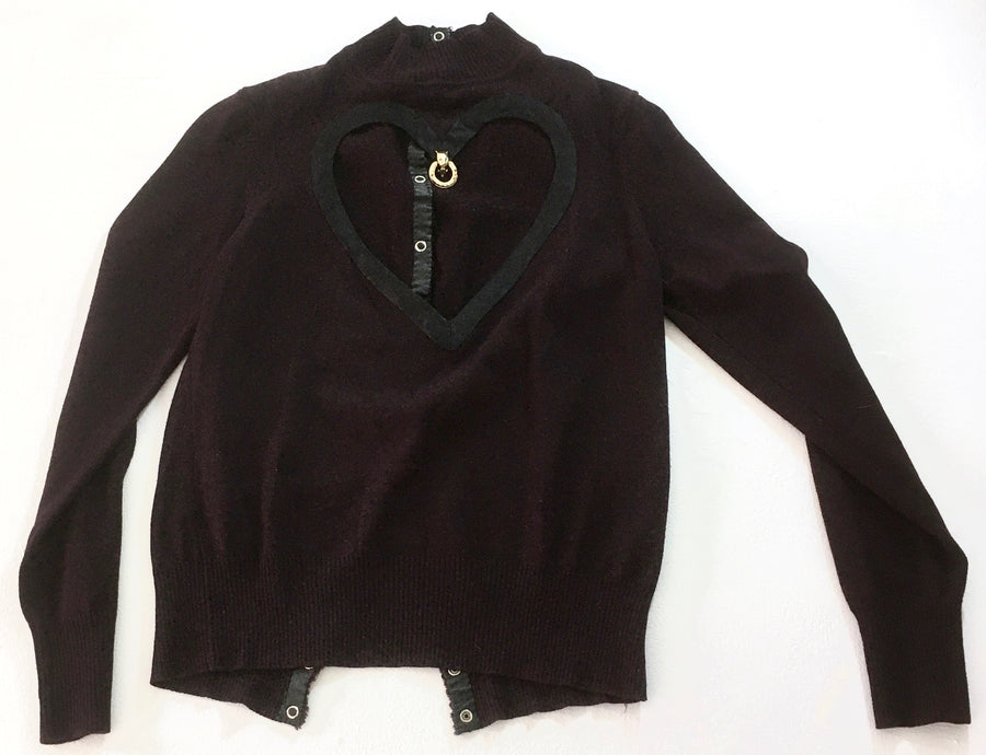 turtleneck sweater with heart cut out and gold charm