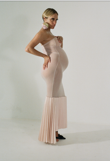 long pink tube dress with asymmetrical fan bottom