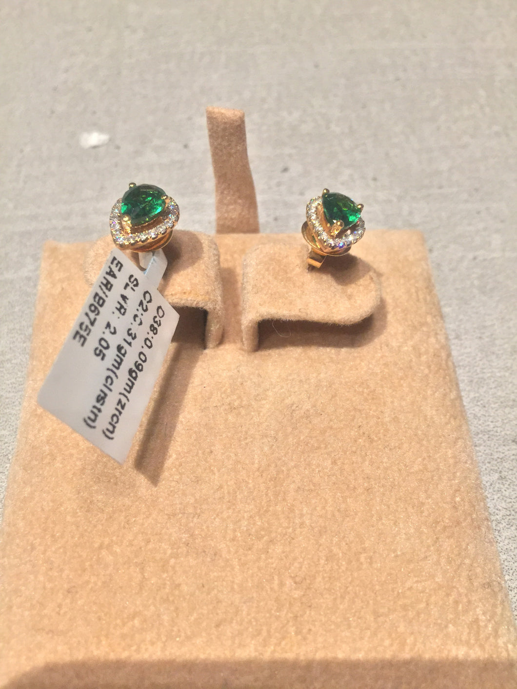Gold plated emerald color zirconium earrings.