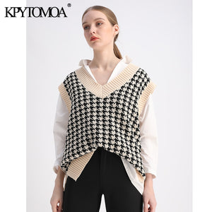 Over sized houndstooth knitted vest.