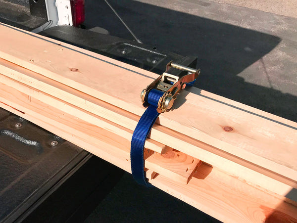 Endless loop tie-down holding lumber