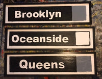 Queens Grey Line Subway Sign