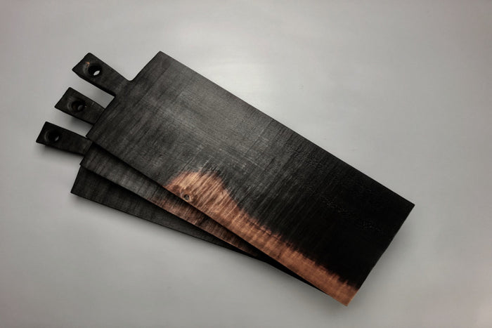 Long charred cherry wood bread boards