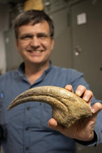 Load image into Gallery viewer, Paleontologist Dr. Brian Curtice photograph with dinosaur claw