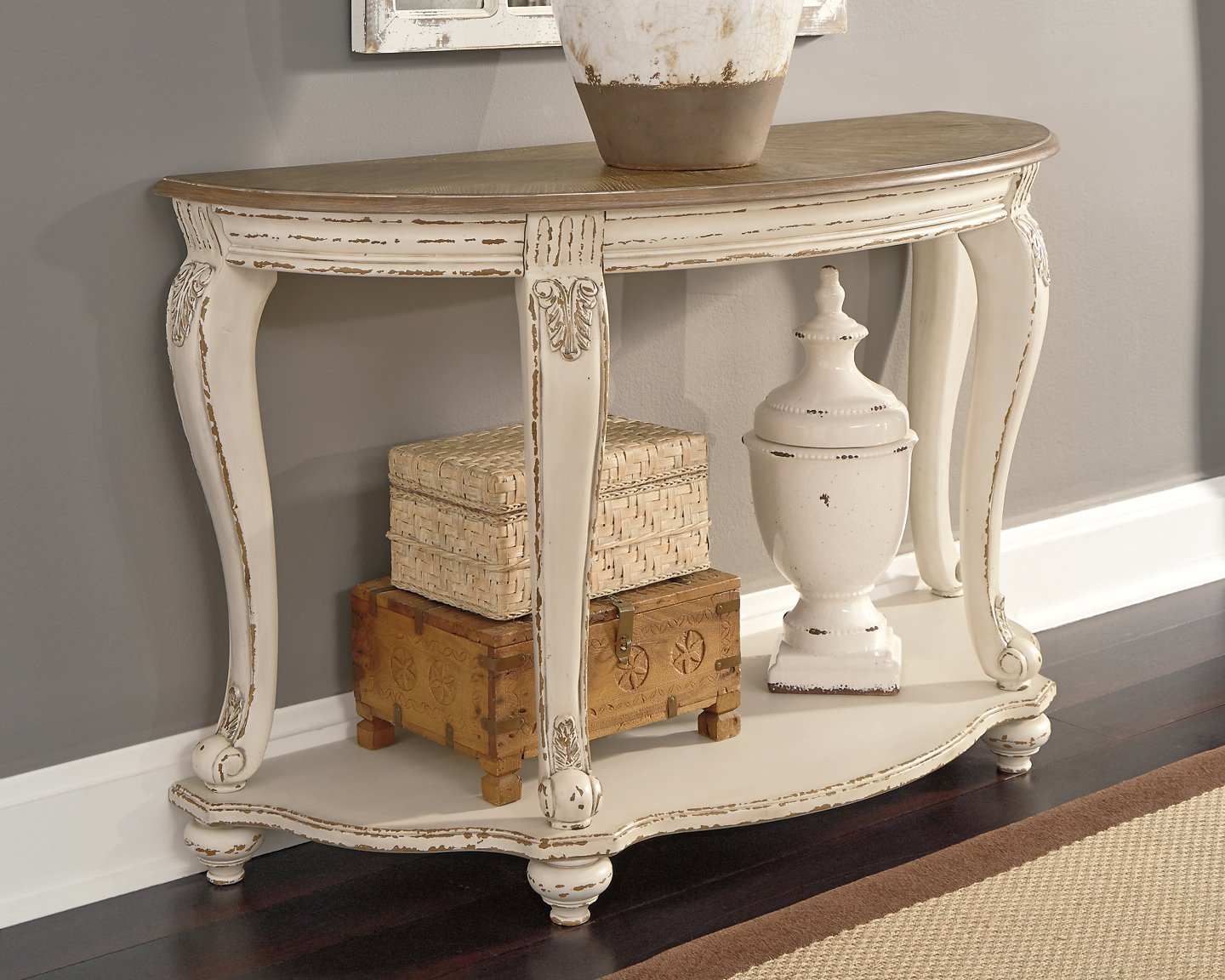 Realyn Signature Design by Ashley Sofa Table image