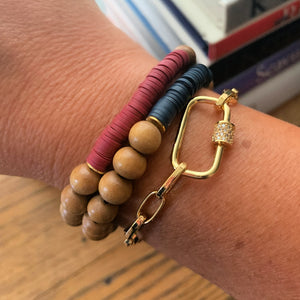 Libby & Smee gold carabiner bangle bracelet with pave lock, shown with wood bead heishi bracelets