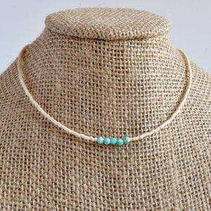 Libby & Smee matte cream beaded choker necklace with turquoise Amazonite accent beads on mannequin