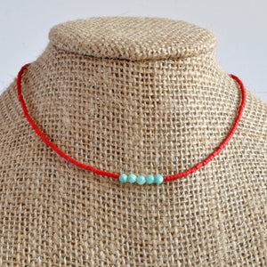 Libby & Smee matte red beaded choker necklace with turquoise Amazonite accent beads on mannequin