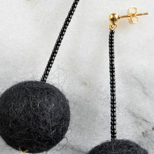Libby & Smee pom pom earrings in Black with Black color combination, close up