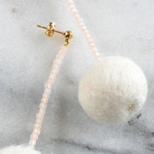 Libby & Smee pom pom earrings in Cream with Blush color combination, close up